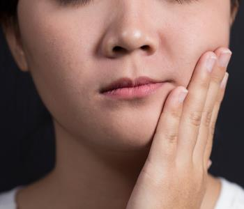 Saves tooth from extractions by visiting Greensboro Root Canals Dentist